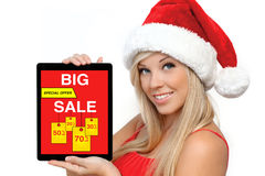 Woman red Christmas hat holding tablet computer  with big sale Stock Photo