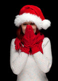 Woman in red Christmas hat and mittens Stock Images