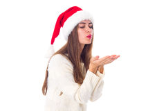 Woman in red christmas hat sending air kiss Stock Photo