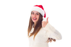 Woman in red christmas hat showing thumb up Royalty Free Stock Photography