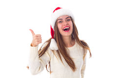 Woman in red christmas hat showing thumb up Royalty Free Stock Photo