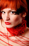 Woman with red clew. Young woman with red clew on her neck Royalty Free Stock Image