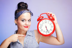Woman with red clock. Time management concept. Stock Images