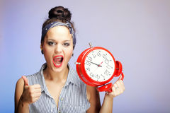 Woman with red clock. Time management concept. Stock Photos
