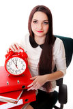 Woman with red clock. Time management concept. Stock Photography