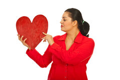 Woman in red clothes holding heart Stock Images