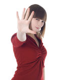 Woman in red clothes showing stop sign Stock Photos