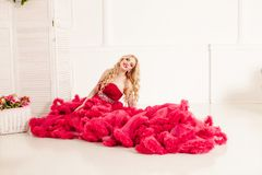 Woman in red cloudy dress Royalty Free Stock Photography