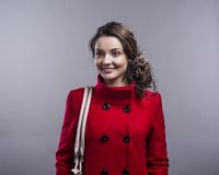 Woman in red coat Stock Photos