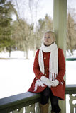 Woman in red coat dreaming at boundary Stock Photo