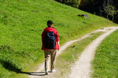 Woman with red coat is hiking Royalty Free Stock Photography