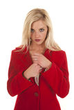 Woman red coat hold knife by chest looking Stock Photo