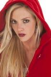 Woman red coat hood serious stock photos