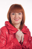Woman in a red coat. On a white background in the studio Royalty Free Stock Photography