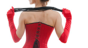 Woman in a red corset and whip. On white background Stock Image
