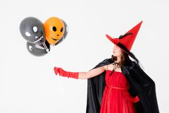 Woman in red dress with fake axe on head on white background. Co royalty free stock images