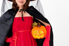 Woman in red costume holding pumpkin, portrait studio shot on white background stock image