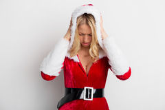 Woman in red costume with the hood holding her head. Woman in red costume with the hood Stock Photography