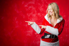 Woman in red costume pointing with both hands Royalty Free Stock Image