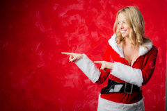 Woman in red costume pointing fingers Royalty Free Stock Photo