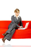 Woman on red couch Royalty Free Stock Photos
