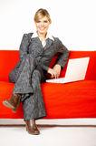 Woman on red couch Stock Photography