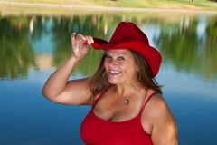 Woman in Red Cowboy Hat Royalty Free Stock Photography