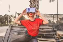 Woman in Red Crew-neck T-shirt Wearing Virtual Reality Glasses Stock Image