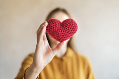 Woman with a red crocheted heart Royalty Free Stock Images