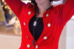 Woman in red with cross and jewelry. With white label Stock Photo