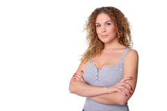 Woman with red curly hair and arms crossed hands, copy spase Royalty Free Stock Image