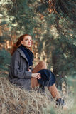 Woman with red curly hair outdoors Royalty Free Stock Image