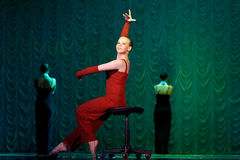 Woman in red dancing on stage Royalty Free Stock Photo