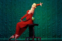 Woman in red dancing on stage Stock Image