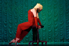 Woman in red dancing on stage Royalty Free Stock Images