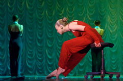 Woman in red dancing on stage Stock Images