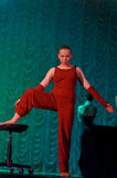Woman in red dancing on stage Stock Photos