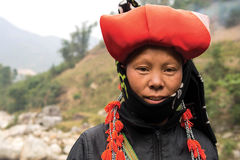 Woman from Red Dao Minority Group in Sapa, Vietnam. Woman from Red Dao minority group wearing traditional headdress at Ban Ho village, Sapa District, Lao Cai Royalty Free Stock Images