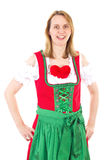 Woman in red dirndl waiting for her valentine Royalty Free Stock Photos