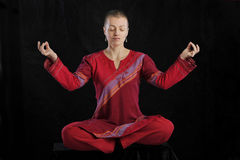 Woman in red doing yoga Stock Photography
