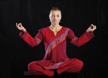 Woman in red doing yoga Royalty Free Stock Photography