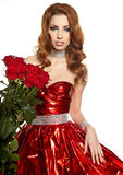 Woman in red drapery with red roses Royalty Free Stock Images