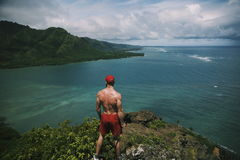 Woman in Red Drawstring Shorts With Fitted Cap Standing on Mountain Cliff Beside Sea Royalty Free Stock Photos