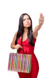 The woman in red dres after shopping isolated on white Royalty Free Stock Images