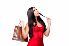 The woman in red dres after shopping isolated on white Royalty Free Stock Photos