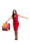 The woman in red dres after shopping isolated on white Royalty Free Stock Photo