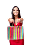 The woman in red dres after shopping isolated on white Stock Image