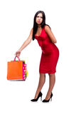 The woman in red dres after shopping isolated on white Royalty Free Stock Photography