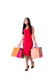 The woman in red dres after shopping isolated on white Stock Photos