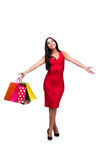 The woman in red dres after shopping isolated on white Stock Images